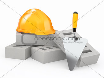 Bricks, hardhat and trowel. 3d