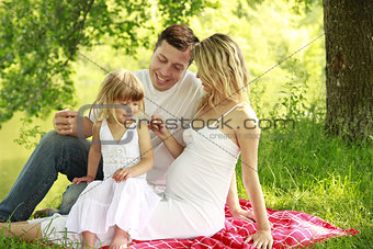 Young family on the nature