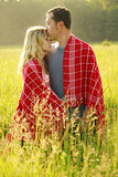 couple in love outdoors on a field