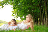 Mama and her little daughter playing on grass