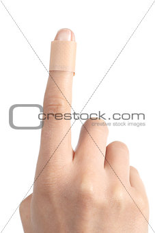 Forefinger of a woman hand with a band aid