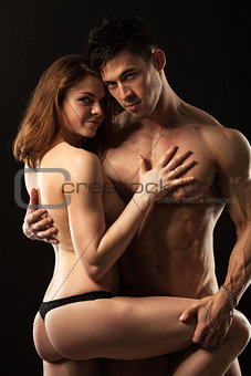 Beautiful athletic couple over black