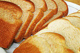 Light and Dark Wheat Bread Slices on Plate