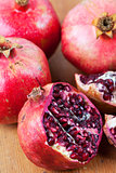 Freshly cut open pomegranate on wooden surface