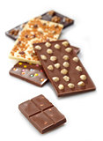 Various chocolate bars on white background