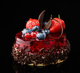 cake with fresh berries and chocolate