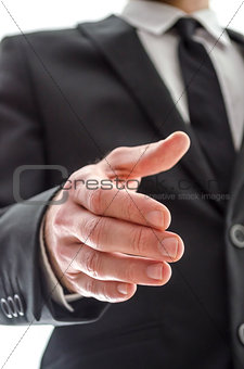 Business man offering a handshake
