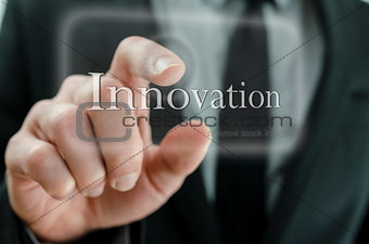 Business man pressing Innovation button on a touch screen interf