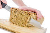 Cutting a homemade bread on a wooden board