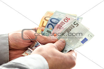 Closeup of a man holding Euro money banknotes
