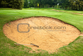 Gold course bunker with rake