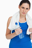 Sportswoman with a towel and a bottle