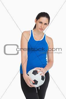 Sportswoman holding a soccer ball