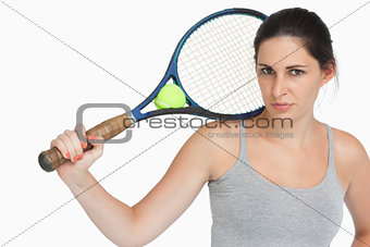 Sportswoman with a tennis racket
