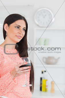 Beautiful brunette holding a glass of wine