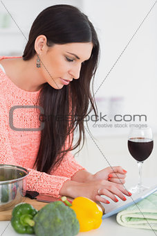 Brunette using a tablet computer
