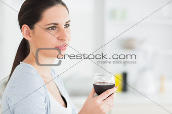 Brunette holding a red wine glass