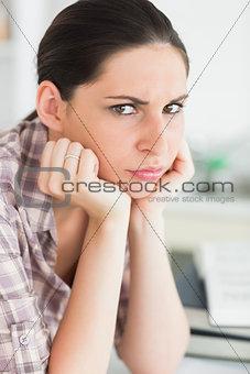 Upset woman looking at camera