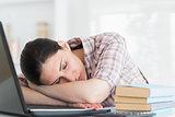 Woman resting on laptop
