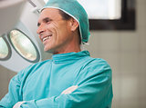 Surgeon smiling with arms crossed