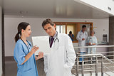 Two doctors standing in the hall