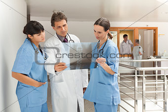 Three doctors looking at a x-ray