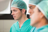 Three surgeons in operating theatre
