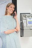 Happy patient using payphone