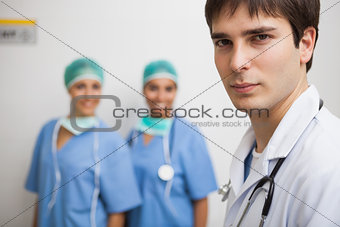 Satisfied doctor with two nurses