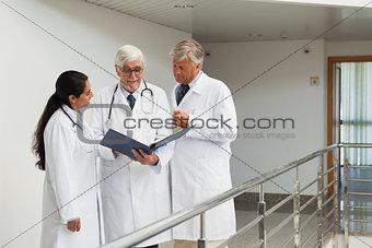Three doctors talking