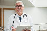 Doctor smiling in hospital corridor