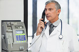 Doctor on a payphone