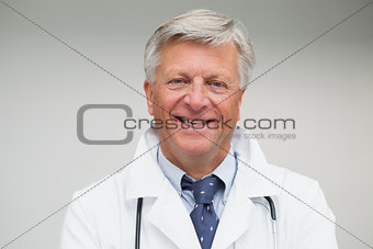 Mature doctor smiling