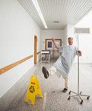 Patient pretending to slip on wet floor