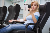 Blonde woman relaxing in a chair while getting dialysis