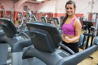 Smiling woman on a treadmill in the gym