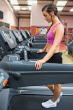 Woman resting on the treadmill after exercising