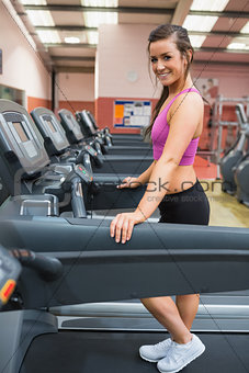 Woman taking a break on the treadmill