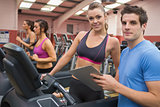 Gym Instructor and woman in the gym