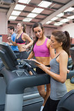 Female Gym Instructor and woman in the gym