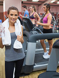 Woman holding towel in gym