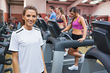 Woman smiling in the gym
