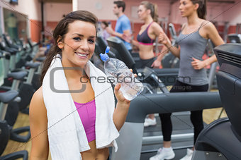 Woman smiling with bottle of water
