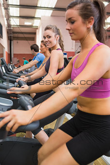 Woman looking to the side on exercise bicycle