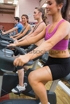 People exercising on exercise bicycles