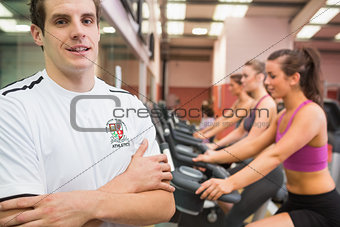 Man with arms crossed in gym