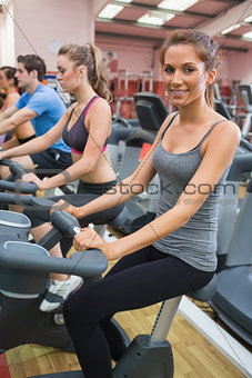 Woman smiling at camera in the gym