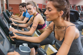 Blonde enjoying exercising on exercise bike