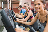 Four people working out on exercise bikes