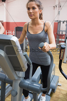 Brunette stepping on a step machine